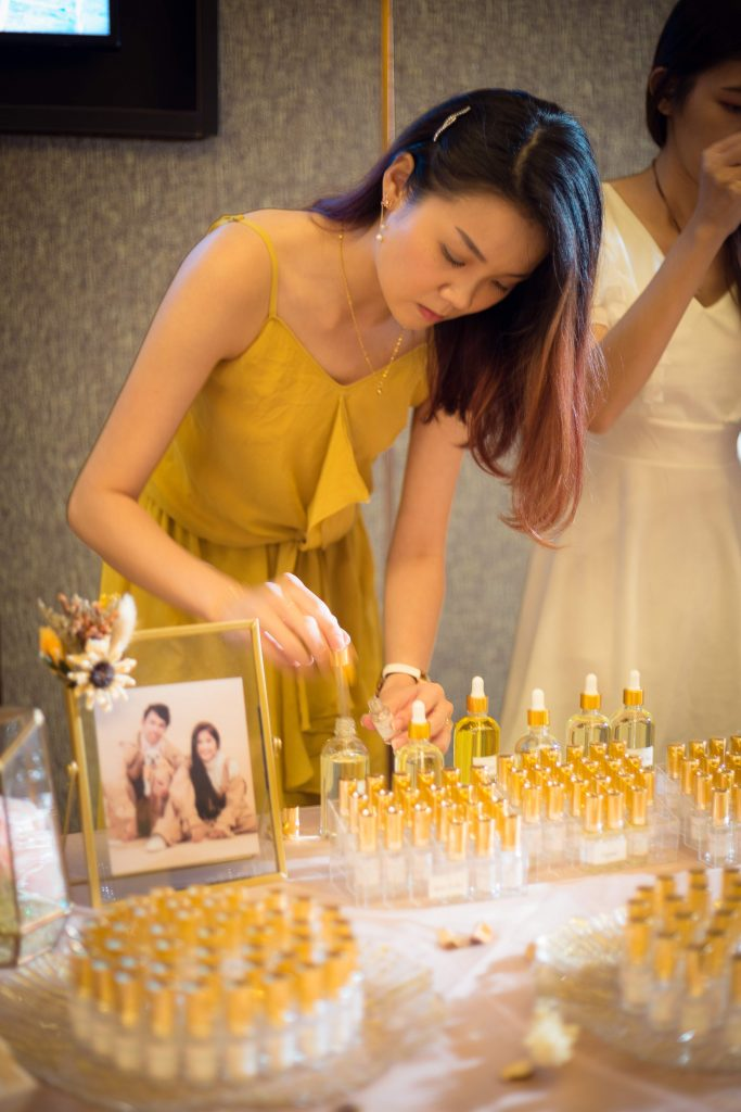 Guest filling up the perfume after choosing the perfume scent